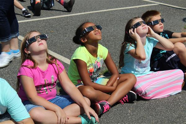 Students watching solar eclipse at WYES on Monday, August 21, 2017