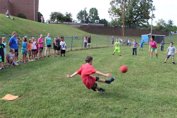 Students playing kickball afterschool on September 21, 2017