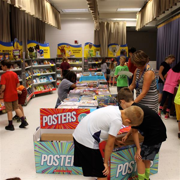 Students checking out the selection at the book fair.