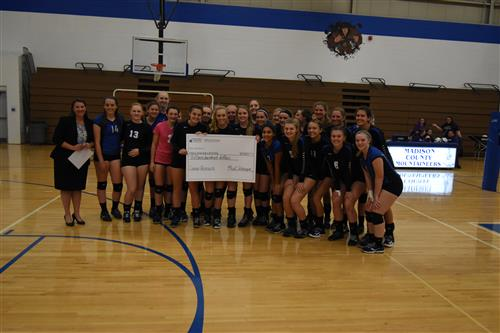 Madison County Volleyball teams present donation check