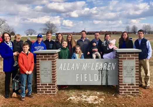 Allan McLearen and family in front of sign dedication
